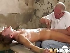 Mature master Sebastian Kane plays with slave Eli Manuel